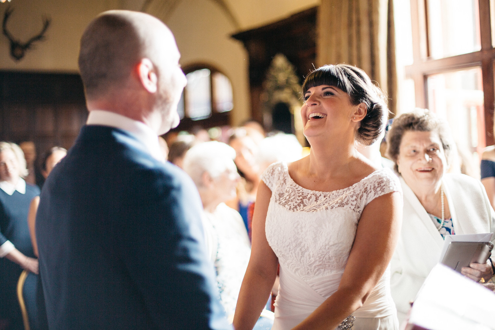 huntsham-court-wedding-ceremony-laughter